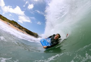 Bodysurfing the giant waves, Cornwall