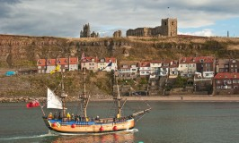 Replica Endeavour and Whitby Abbey..