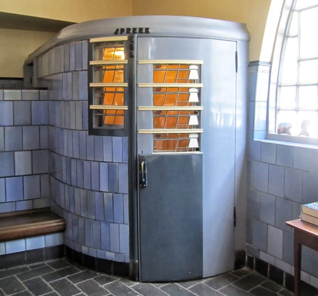 Telephone booth in the former post office in apartment building and museum Het Schip in Amsterdam