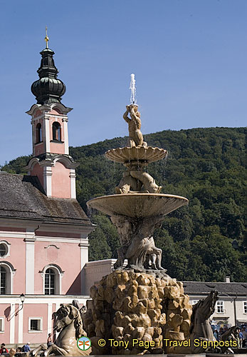 Baroque Residence fountain with St. Michael's Church in the background