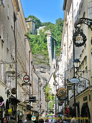 Getreidegasse - a charming narrow shopping strip decorated with wrought iron guild signs