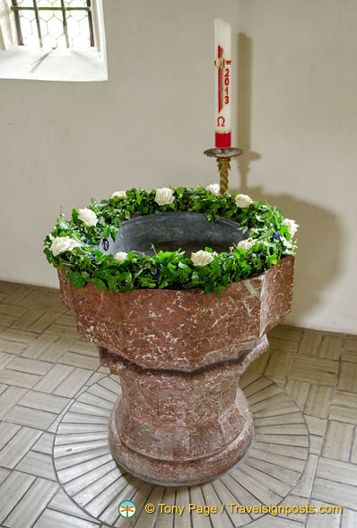Holy water stoup in Weissenkirchen white church