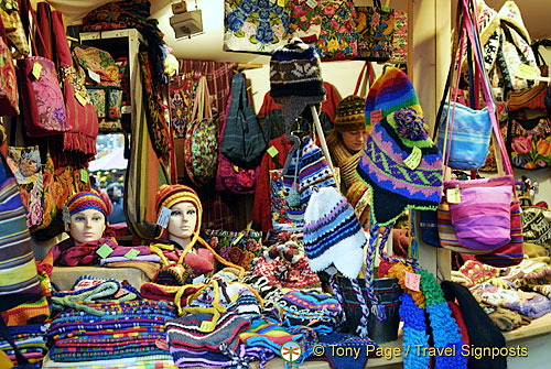 This stall offers colorful woollen beenies, scarfs and matching bags