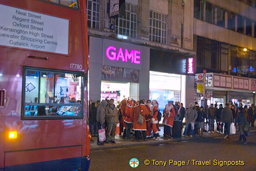 Santas queuing for work