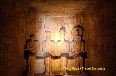 On two days of the year the sun's rays reach these once gold-covered statues.