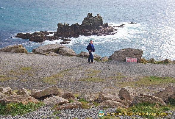 Tony checking out the dangerous cliff sign