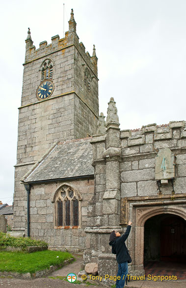 St Just Church - me pointing to an ancient sundial