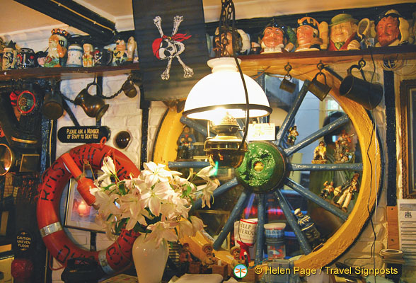 All kinds of nautical artefacts decorate each inch of space in the Benbow Inn