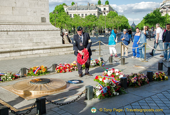 A ceremony at the Memorial Flame of the Arc de Triomphe