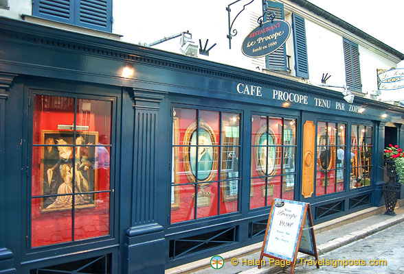 Exterior of Cafe Procope with images of its famous clientele