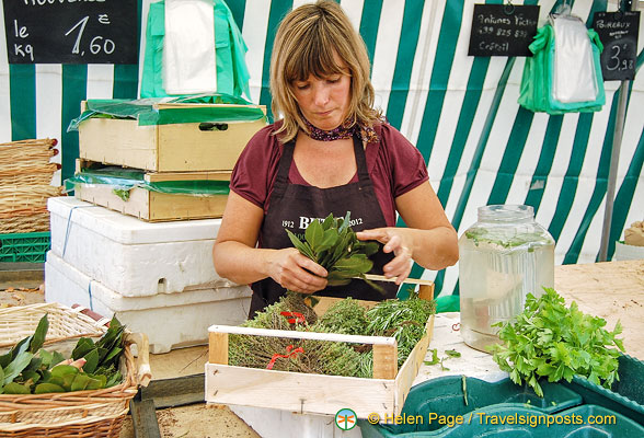 Stallholder packing up her herbs