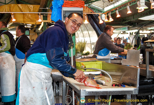 A friendly fishmonger at work