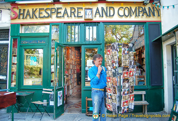 Tony, checking out the postcards at Shakespeare and Co