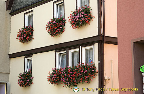 Beautiful flower baskets decorate many of the windows in town