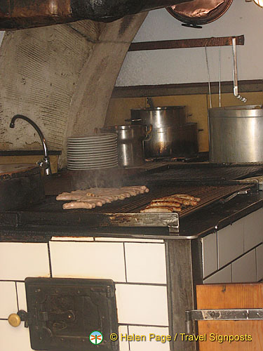Sausages being cooked