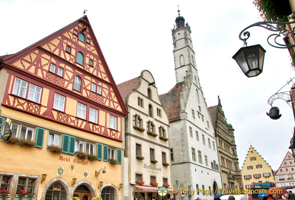 The white building with the tower is the Rathaus on Marktplatz