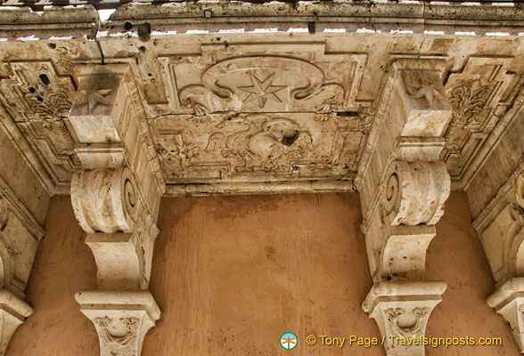 Decorative stonework under the balcony