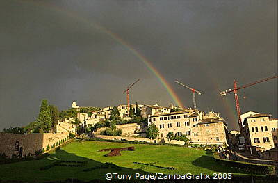 As Assisi reconstructs, cranes mark the skyline of the city