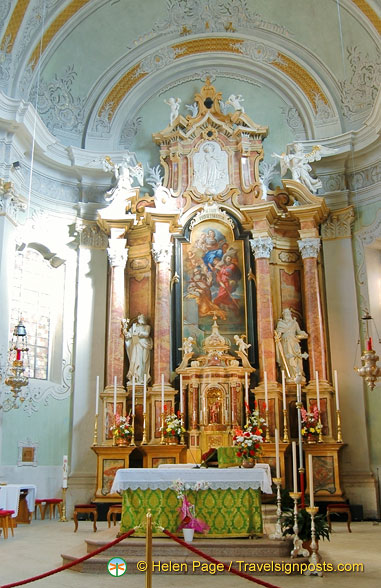 The main altar of the Parish Church of Cortina d'Ampezzo with statues of Saints Peter and Paul