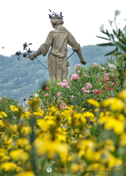 Beautiful flowers and statue in Isola Bella gardens