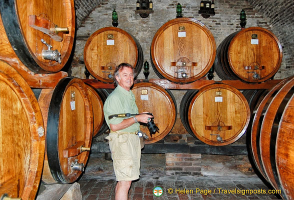 Tony checking out the wine barrels