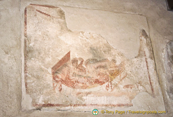 Erotic images like this can be seen over the entrance to each Lupanar room