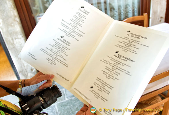 Checking out the menu of Osteria Oliva Nera