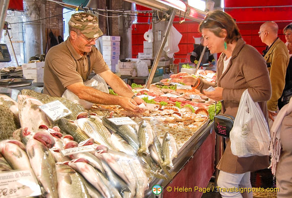 An early shopper at the fish market