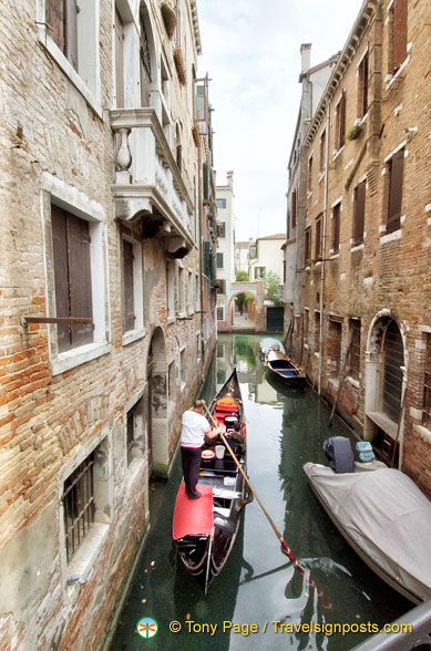 A goods carrying gondola in the back canals of Venice