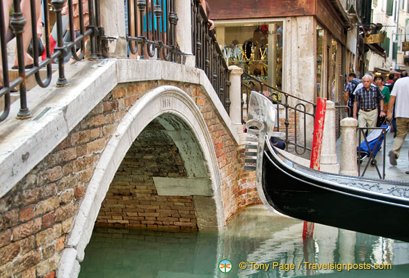 This gondola will just about make it under this bridge