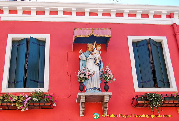 Altars like this decorate many of the buildings in Burano