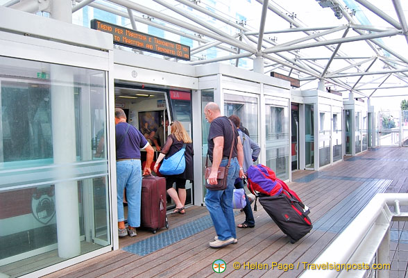 Passengers boarding the people mover