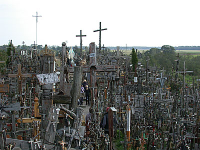 The hillock is covered by thousands of crosses