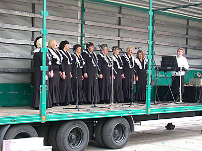 Choral group performing from a mobile stage