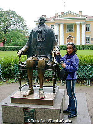 Touching the hand of Peter the Great to receive good wishes