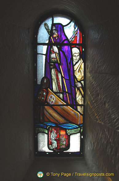 Stained glass window depicting St Columba