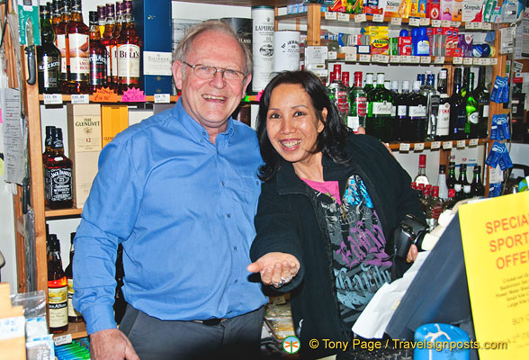 Helping the manager of Laggan Stores at the till
