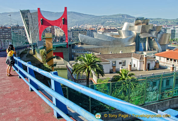 The Guggenheim tower, the Red Arches and the Guggenheim Bilbao set against Mt Artxanda