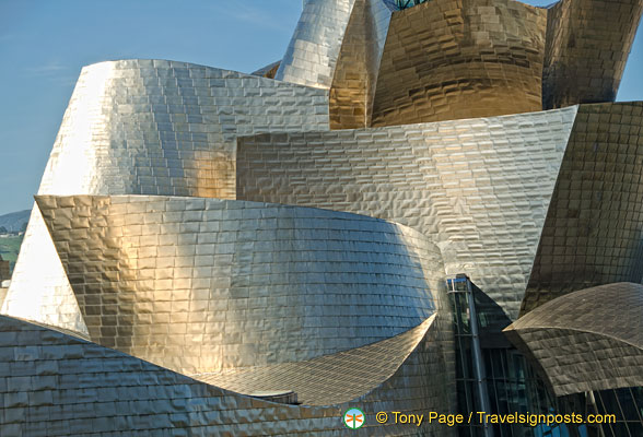 Guggenheim Bilbao titanium panels catching light from different angles