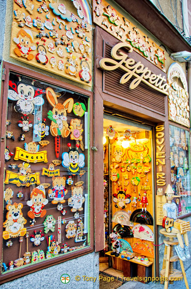 Geppetto has a collection of wooden craft items made ​​in Italy.