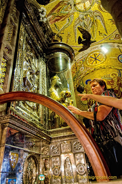 The faithful touching the orb of the Black Madonna
