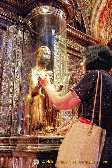 Pilgrims and the faithful come to Montserrat Basilica to touch the wooden orb of the Black Madonna