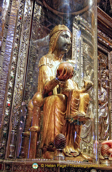 The Black Madonna's wooden orb protrudes through the glass for pilgrims to touch
