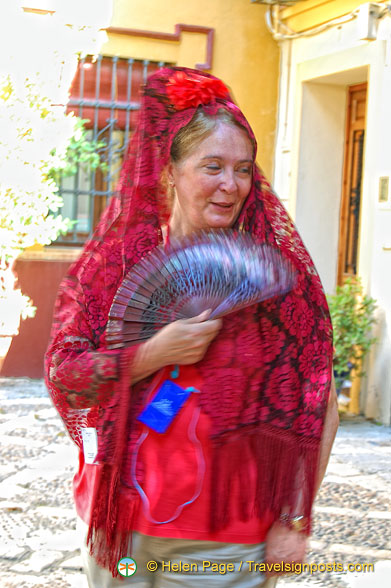 Dressed in the traditional mantilla and Spanish fan