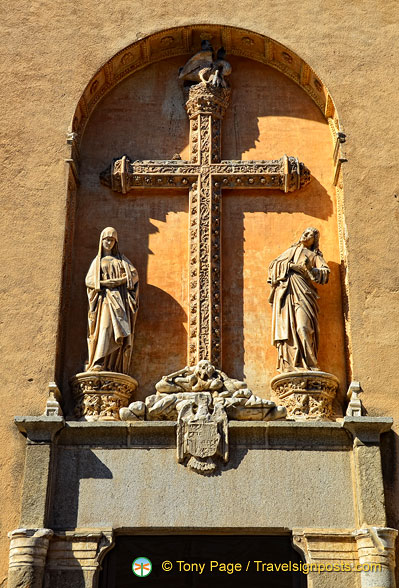 The cross is richly carved with plant motifs
