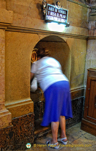 A faithful kissing the Holy Pilar