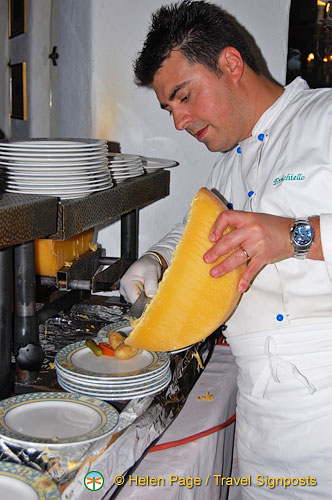 Chef preparing raclette
