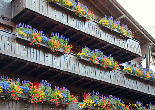 Colourful floral baskets at this Zermatt chalet