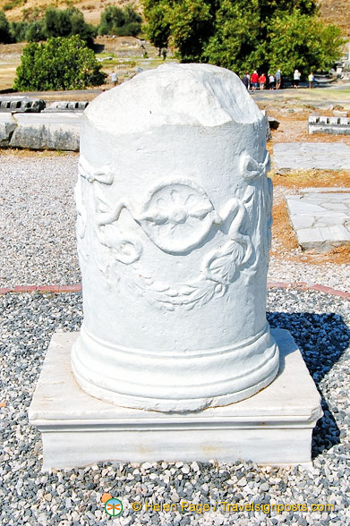 This column with two serpents is a symbol of medicine. Snakes renew their bodies by shedding skin and hence the belief that snakes have healing power.