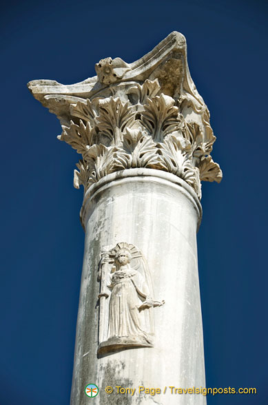 Close-up of column with engraving on it